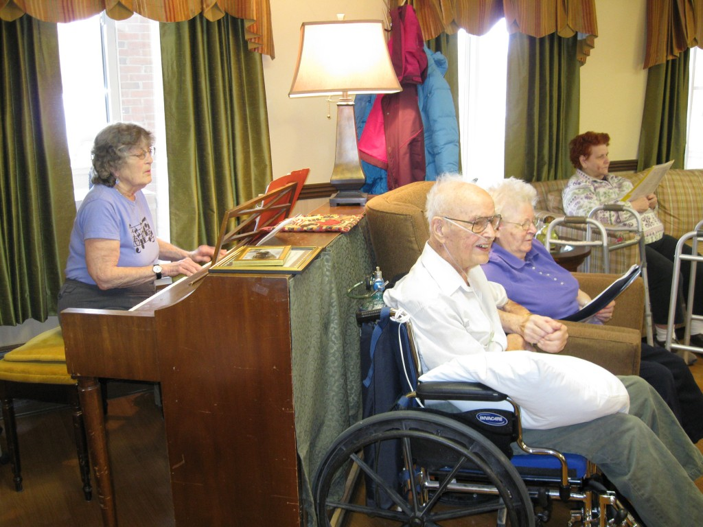The oldest man award was presented at the weekly singalong held at the St. Johnsbury Rehab. Winona Gadapee is at the piano and Arnold and Shirley enjoy front and center.