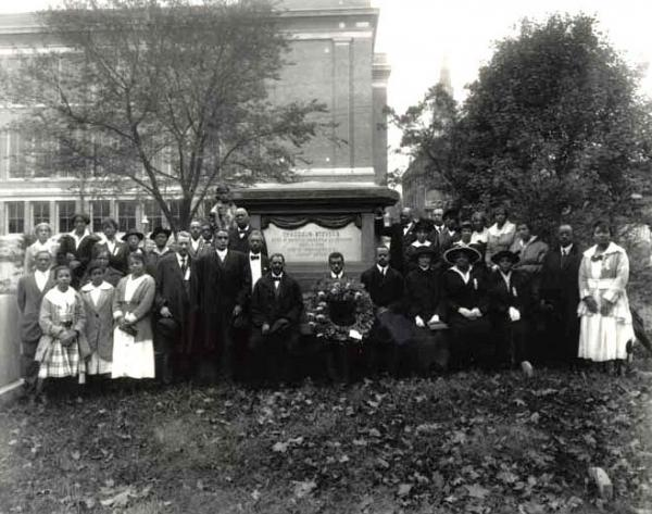 Members of the Negro Civic Congress pose in front of the Thaddeus Steven's monument in Shreiner's Cemetery, Lancaster, PA, circa 1920.