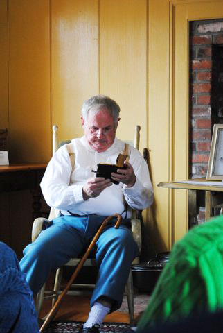 Abel Morrill (David Book) reading the last words from his son's Bible.