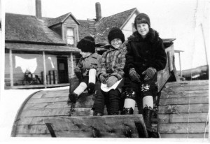The Watson children, taken at the Watson farm in Walden on top of the snow roller. Her father rolled the roads. Toppy on the right, Lucille in the center and Roy on the left. Photo courtesy of Toppy Sherry.