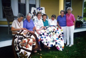 Toppy belonged to a local quilting group that met and worked together for 20 years. They are gathered here for the photo on Toppy's front porch.  From l to r: Lorette Desrochers, Marilyn Moulton, Doreen Fraser, Fran Gingue, Toppy Sherry, Janice Currier and Lucia Pearl. Missing from photo is Rose Desrochers and Joanne Schyler.