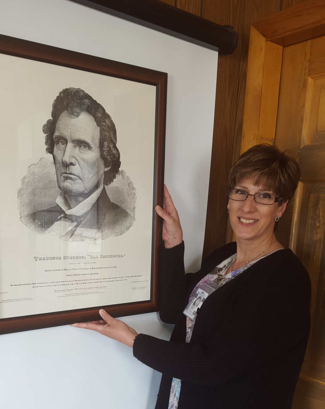 Lindi Pronto, Danville postmaster, holds the Thaddeus Stevens portrait that hangs in the Danville, VT, post office. Last year, the post office was named for Thaddeus Stevens.