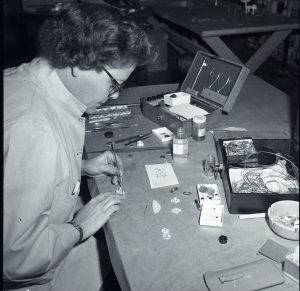 Schroeder preparing an exhibition, 1956. Courtesy Cranbrook Archives.